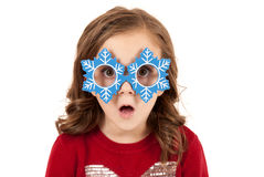Girl with funny expression in snowman glasses Stock Photos