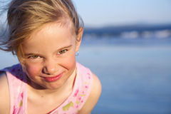 Girl with funny face. Little girl making a funny expression royalty free stock photos