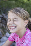 Girl with funny face Stock Photos