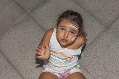 Girl funny face expression and rainbow painted. High angle Royalty Free Stock Photos