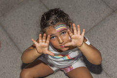 Girl funny face expression and rainbow painted. High angle Stock Photos