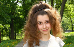 Girl with funny haircut. In the city park Royalty Free Stock Image