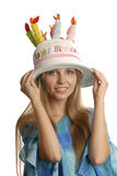 A girl in funny hat. A smiling girl in a big funny hat which seems like birthday cake Stock Photo