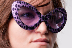 Girl with funny sunglasses Royalty Free Stock Photos