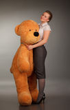 Girl with funny toy bear Stock Image