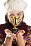 Girl with a funny trophy Stock Images