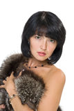 Girl with fur. Serious girl with fur isolated on white background stock photography