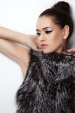 Girl in fur Stock Images