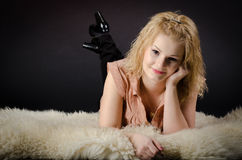Girl on fur Royalty Free Stock Image
