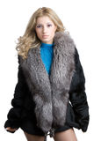 Girl in a fur. Nice girl in a fur coat isolated on a white background royalty free stock photo