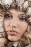 Girl with fur around her face Stock Photography