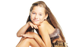Girl in the fur as a prehistoric. Little girl in the fur as a prehistoric Royalty Free Stock Photos