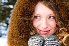 Girl in fur cap Royalty Free Stock Image