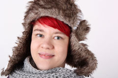 Girl with fur cap Stock Image