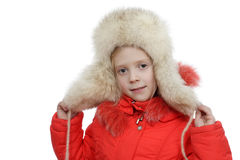 The girl in a fur cap Royalty Free Stock Photos