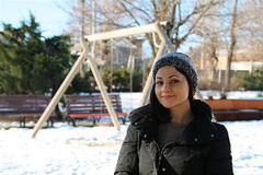 Girl with fur cap in park Stock Image