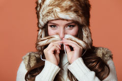 Girl in fur cap Royalty Free Stock Images