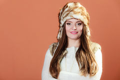 Girl in fur cap Stock Photos