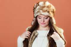 Girl in fur cap Stock Photo