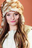 Girl in fur cap Royalty Free Stock Photo