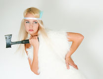 The girl in a fur cape with an axe Stock Photography