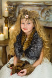 The girl in fur clothes Royalty Free Stock Photos