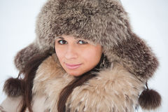 girl in fur clothing laughing Royalty Free Stock Photo