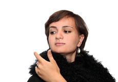 Girl in a fur coat. Young girl wearing black fur coat and pearl earings Stock Photos