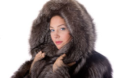 Girl in a fur coat Royalty Free Stock Image