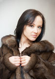 GIRL IN A FUR COAT Royalty Free Stock Images