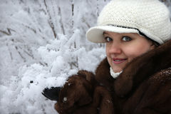 The girl in a fur coat Stock Photos