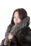 Girl in a fur coat Royalty Free Stock Photography