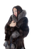 Girl in a fur coat Stock Image