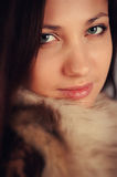 Girl in a fur coat. Portrait of a beautiful girl in a fur coat Royalty Free Stock Images