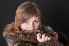 Girl in a fur coat Royalty Free Stock Photo