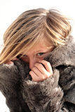 Girl in a fur coat Stock Images