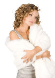 Girl is in a fur coat Royalty Free Stock Photography