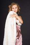 Girl is in a fur coat Stock Photos