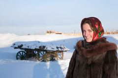Girl in  fur coat against  winter rural landscape Stock Images
