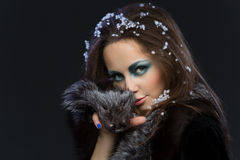 Girl in fur coat Stock Images