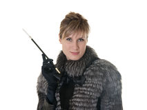 Girl in a fur coat with cigarette Stock Photos