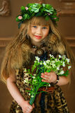 The girl in a fur coat with flowers Royalty Free Stock Image