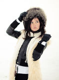 Girl in a fur coat, hat and gloves. Cute girl in a fur coat, hat and gloves Stock Photography