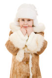 A girl in a fur coat and hat smiling Stock Photos
