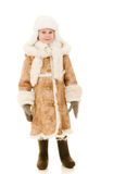 A girl in a fur coat and hat smiling Stock Photography