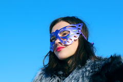 Girl in fur coat and mask Stock Photos