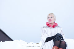 Girl in fur coat poses girl on snow Royalty Free Stock Photos