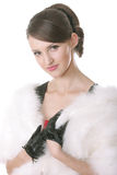 Girl in fur coat posing Stock Photo