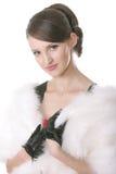 Girl in fur coat posing Stock Photo