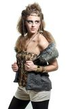 Girl in a fur coat. Standing native woman in a fur coat stock images